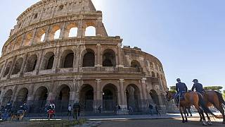 FILE: Mounted policemen and Carabinieri outside the Colosseum in Rome, June 1, 2020.
