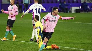 Barcelona's Lionel Messi celebrates after scoring his side's third goal during a Spanish La Liga soccer match between Valladolid and Barcelona