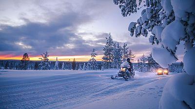 Sunrise safari by electric snowmobiles