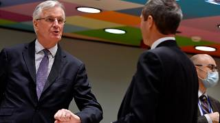European Union's chief Brexit negotiator Michel Barnier, left, speaks with Ambassador Michael Clauss, Permanent Representative of Germany to the European Union, during a meeti