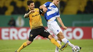 Dynamo's Philipp Hosiner, left, with Darmstadt's Lars Lukas Mai, during their German Bundesliga 2nd round match at the Rudolf-Harbig-Stadion in Dresden, Dec 22, 2020.