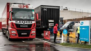 Trucks wait outside of loading bays at Pfizer Manufacturing in Puurs, Belgium