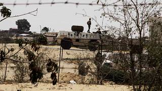 In this Monday, Aug. 6, 2012 file photo, Egyptian border guards patrol near the border with Israel in Rafah, Egypt