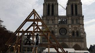FILE PHOTO Carpenters put the skills of their Medieval colleagues on show on the plaza in front of Notre Dame Cathedral in Paris, France, Sept. 19, 2020