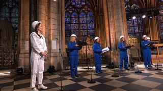 In this photo provided by Maitrise Notre-Dame de Paris soprani singer Julie Fuchs and the Notre Dame Cathedral choir recording a Christmas concert
