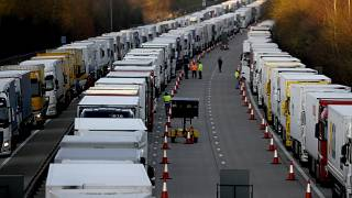 Trucks are parked up on the M20, part of Operation Stack in Ashford, Kent, England, Friday, Dec. 25, 2020.