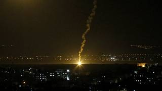 FILE PHOTO - Flares fired from Israeli forces light up the night sky in Gaza City, Monday, Nov. 12, 2018