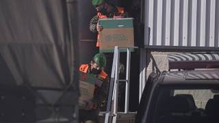 Spanish army soldiers carry the first batch of the Pfizer coronavirus vaccine in a warehouse in Cabanillas del Campo, outskirts of Guadalajara, central Spain, Dec. 26