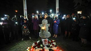 People commemorate Roman Bondarenko, an anti-government protester who died after what witnesses said was a severe beating by security forces, Dec. 21, 2020