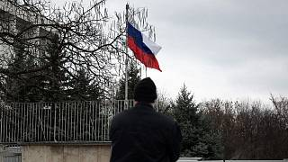 A Bulgarian police officer stands in front of Russian embassy in Sofia.
