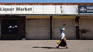 South Africa bans alcohol sales, tightens curfew to fight COVID surge