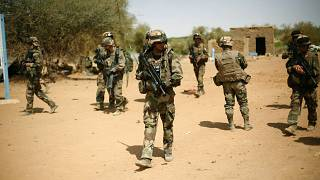 FILE-- In this photo taken Sunday Feb. 10, 2013, French soldiers secure the area where a suicide bomber exploded at the entrance of Gao, northern Mali.