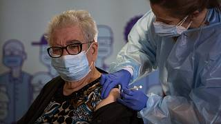 Josefa Perez, 89, is vaccinated against the Corona virus at a nursing home in l'Hospitalet de Llobregat in Barcelona, Spain, on Sunday, Dec. 27, 2020.