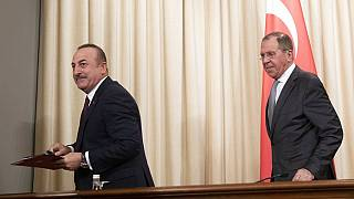 Turkish Foreign Minister Mevlut Cavusoglu, left, and Russian Foreign Minister Sergey Lavrov