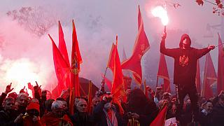 People shout slogans during a protest against the new government in Podgorica, Montenegro, Monday, Dec. 28, 2020.