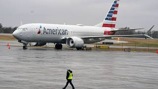 FILE - In this Dec. 2, 2020 file photo, an American Airlines Boeing 737 Max jet plane is parked at a maintenance facility in Tulsa, Oklahoma.