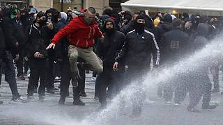 Water canon is used against demonstrators as they gather to protest against the COVID-19 restrictive measures at Old Town Square in Prague, Czech Republic