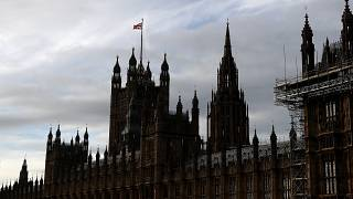 A Union Jack flag flies on top of Parliament during the debate in the House of Commons on the EU (Future Relationship) Bill in London, Wednesday, Dec. 30, 2020.