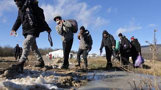Migrants leave to be relocated from the Lipa camp northwestern Bosnia, near the border with Croatia, Bosnia, Tuesday, Dec. 29, 2020.