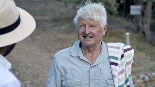 Stanley Johnson, father of Britain's Prime Minister Boris Johnson, speaks with a local reporter, outside his Villa Irene in Horto village, Mount Pelion