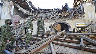 Soldiers inspect the remains of a building damaged in an earthquake, in Petrinja, Croatia, Tuesday, Dec. 29, 2020
