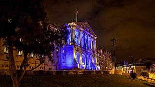 The Portuguese parliament building in Lisbon is illuminated to mark the start of the Portuguese Presidency of the Council of the EU 2021