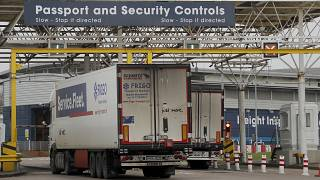 Lorries pass the customs checkpoint in Folkestone, England, Friday, Jan. 1, 2021, the first day after the UK left the EU's single market for people, goods and services.