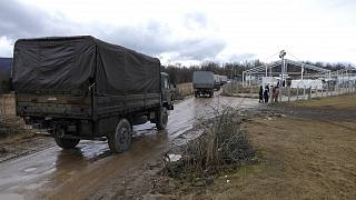 Bosnian soldiers arrive at the Lipa refugee camp outside Bihac, to erect tents for some hundreds of migrants who have been stuck in a burnt out camp.