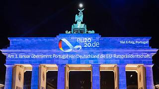 The Brandenburg Gate illuminated with a projection marking the end of the German EU presidency and the handover to Portugal, December 31, 2020 in Berlin.