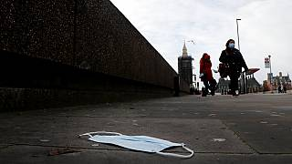 A mask on the pavement near the entrance of a hospital on Westminster Bridge in London this week
