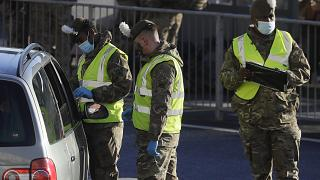 Soldiers carry out a COVID test on a driver at the entrance to The Port of Dover in Kent, England, Friday, Dec. 25, 2020.