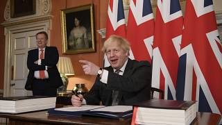 Prime Minister Boris Johnson signs the EU-UK Trade and Cooperation Agreement at 10 Downing Street, London Wednesday Dec. 30, 2020.
