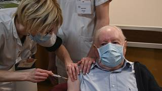 Alain a French 92-year-old man receives a dose of the Pfizer-BioNTech Covid-19 vaccine.