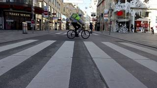 A cyclist drives on a shopping street in downtown Vienna, Austria