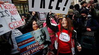 Julian Assange supporters celebrate outside the Old Bailey in London