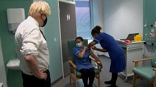 British prime minister Boris Johnson watching nurse receiving vaccine