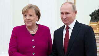 الرئيس الروسي فلاديمير بوتين ، والمستشارة الألمانية أنغيلا ميركل