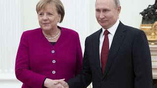 Russian President Vladimir Putin, right, and German Chancellor Angela Merkel pose for a photo prior to the talks in the Kremlin in Moscow, Russia, Jan. 11, 2020.