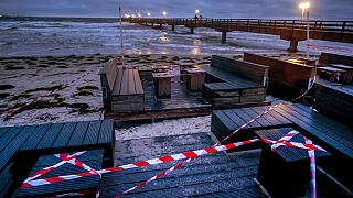 A beach bar is closed due to the lockdown at the pier in Scharbeutz, northern Germany, Tuesday, Jan. 5, 2021.
