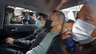 Former law professor Benny Tai, centre, a key figure in Hong Kong's 2014 Occupy Central protests after being arrested by police in Hong Kong, Wednesday, Jan. 6, 2021.