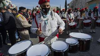 Palestinian scout bands parade outside the Church of the Nativity