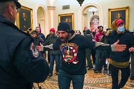 Trump supporters in front of U.S. Capitol Police in the hallway outside of the Senate chamber at the Capitol in Washington, USA. January 6, 2021