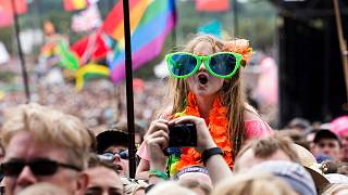 A young fan enjoys the music at the Glastonbury Festival at Worthy Farm, in Somerset, England, Sunday, June 25, 2017