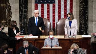 Speaker of the House Nancy Pelosi, D-Calif., and Vice President Mike Pence officiate as a joint session of the House and Senate on January 6, 2021.