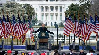 With the White House in the background, President Donald Trump speaks at a rally Wednesday, Jan. 6,