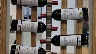 Red wine bottles of the region of Medoc, western France, are displayed at the wine fair in Paris in February 2020.