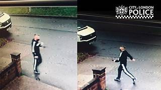 CCTV image of a man wanted in connection with a fake COVID-19 vaccien scam in London.