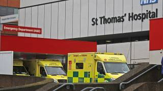 Ambulances are parked at the emergency arrival at St Thomas' hospital in London, Friday, Jan. 8, 2021.