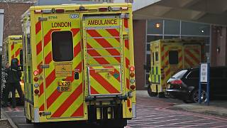 Ambulances are parked at the emergency arrival at Charing Cross hospital in London, Friday, Jan. 8, 2021.