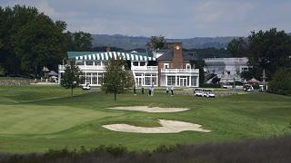 FILE - In this Friday, Oct. 2, 2020, file photo, golfers play golf at Trump National Golf Club in Bedminster, N.J.